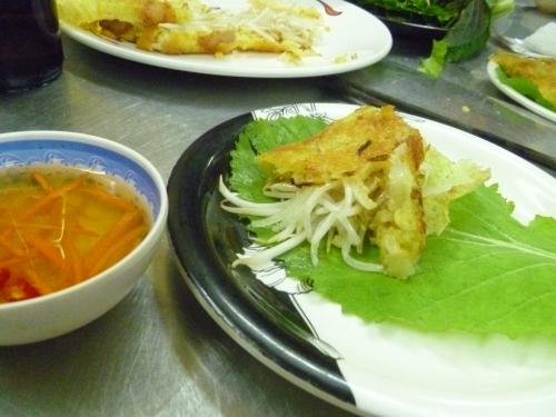 Wrapping Vietnamese pancake.26